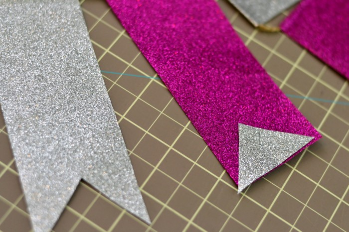 Trim edges and notch the ends to create duct tape bunting.