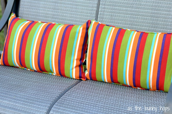 Cozy up your outdoor space with pillows in rainbow stripes.