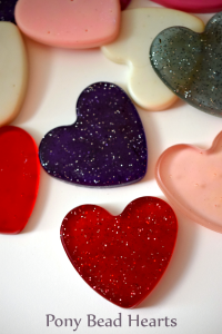 Make easy and fun plastic hearts from Pony Beads! They're a great start to your Valentine's Day crafting projects!