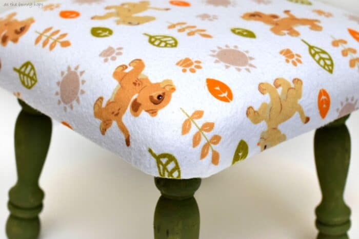 Make a fun upholstered Lion King stool from a receiving blanket! #MagicBabyMoments ad