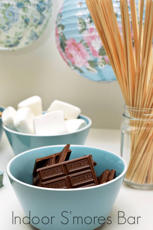 Don't let a rainy day keep you from toasting marshmallows! It's easy and fun to make indoor s'mores! You just need the normal supplies along with a kitchen torch and bamboo skewers. #LetsMakeSmores ad