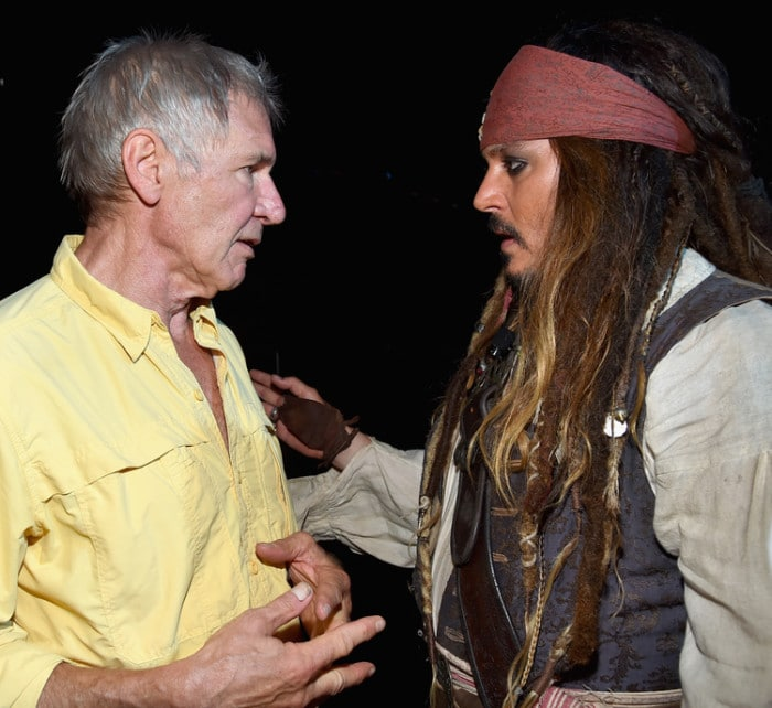 """ANAHEIM, CA - AUGUST 15: Actors Harrison Ford of STAR WARS: THE FORCE AWAKENS (L) and Johnny Depp, dressed as Captain Jack Sparrow, of PIRATES OF THE CARIBBEAN: DEAD MEN TELL NO TALES took part today in """"Worlds, Galaxies, and Universes: Live Action at The Walt Disney Studios"""" presentation at Disney's D23 EXPO 2015 in Anaheim, Calif. (Photo by Alberto E. Rodriguez/Getty Images for Disney) *** Local Caption *** Harrison Ford; Johnny Depp"""