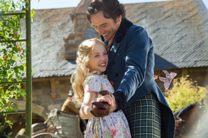 Eloise Webb is young Ella and Ben Chaplin is her father in Disney's live-action CINDERELLA, directed by Kenneth Branagh.