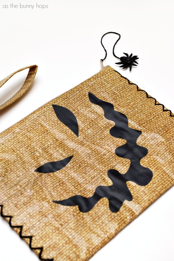 It's an easy to make Oogie Boogie inspired bag made from duct tape! It even has a spider zipper pull!