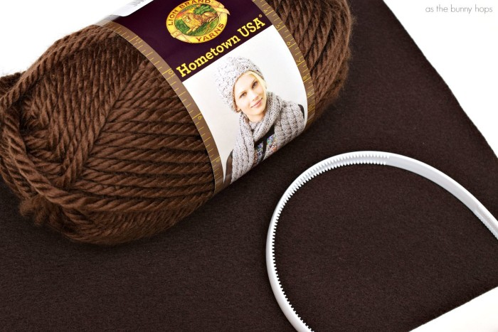 This fun and easy to make Princess Leia yarn headband takes less than 15 minutes to make and costs less than $5!