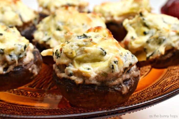 I can never get enough stuffed mushrooms! These spinach artichoke stuffed mushrooms are sure to be a hit at your next gathering.