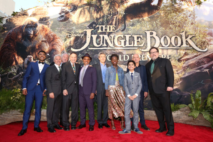 """HOLLYWOOD, CALIFORNIA - APRIL 04: (L-R) Actor Ritesh Rajan, producer Brigham Taylor, composers John Debney, Richard Sherman, actor Giancarlo Esposito, Chairman of the Walt Disney Studios, Alan Horn, actors Lupita Nyong'o, Neel Sethi, Ben Kingsley and director/producer Jon Favreau attend The World Premiere of Disney's """"THE JUNGLE BOOK"""" at the El Capitan Theatre on April 4, 2016 in Hollywood, California. (Photo by Jesse Grant/Getty Images for Disney) *** Local Caption *** Neel Sethi; Lupita Nyong'o; Ritesh Rajan; Ben Kingsley; Giancarlo Esposito; Jon Favreau; Brigham Taylor; John Debney; Alan Horn"""