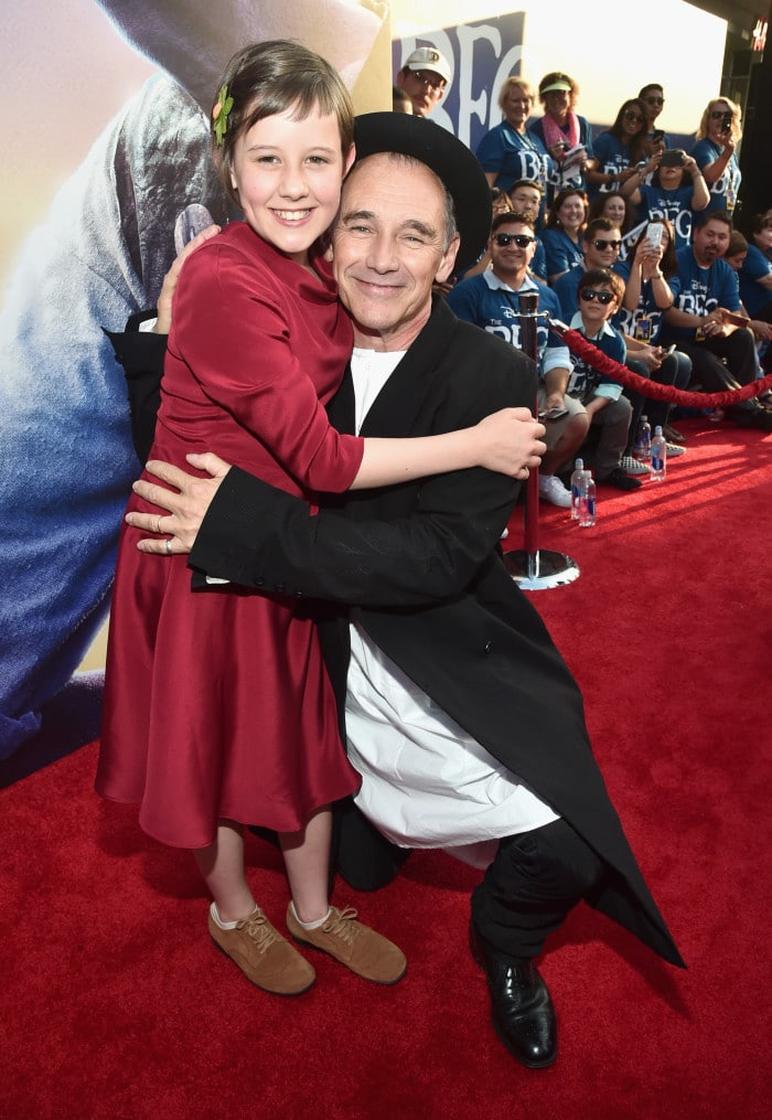"HOLLYWOOD, CA - JUNE 21: Actress Ruby Barnhill (L) and actor Mark Rylance arrive on the red carpet for the US premiere of Disney's ""The BFG,"" directed and produced by Steven Spielberg. A giant sized crowd lined the streets of Hollywood Boulevard to see stars arrive at the El Capitan Theatre. ""The BFG"" opens in U.S. theaters on July 1, 2016, the year that marks the 100th anniversary of Dahl's birth, at the El Capitan Theatre on June 21, 2016 in Hollywood, California. (Photo by Alberto E. Rodriguez/Getty Images for Disney) *** Local Caption *** Ruby Barnhill; Mark Rylance"