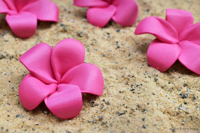 Create cute and fun DIY pink plumeria hair flowers inspired by Disney's Moana!