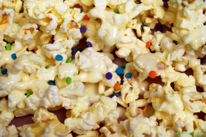 Celebrate family movie night with this easy birthday cake popcorn recipe! It's ready to enjoy in just a few minutes and it only requires three ingredients!