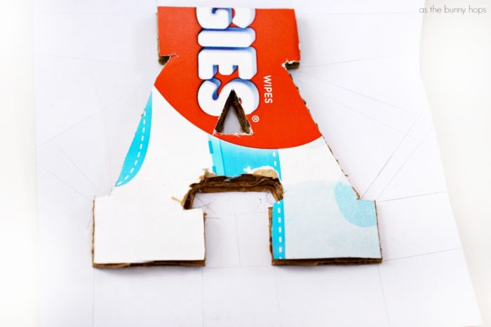 Make your own sports-themed nursery letters with cardboard and scrapbooking paper!