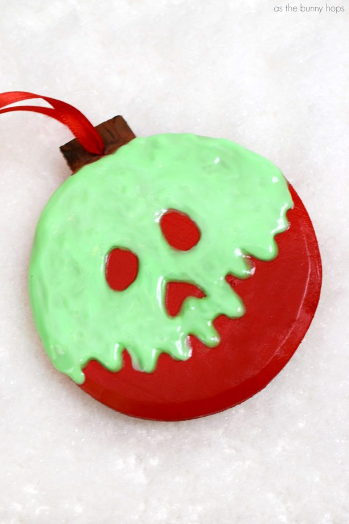 Create your own Snow White-inspired Poison Apple ornament for your Christmas tree with this simple DIY project!