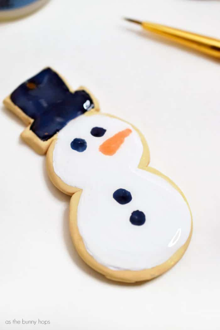 Enjoy a calorie-free treat when you make adorable snowman sugar cookie ornaments from polymer clay!