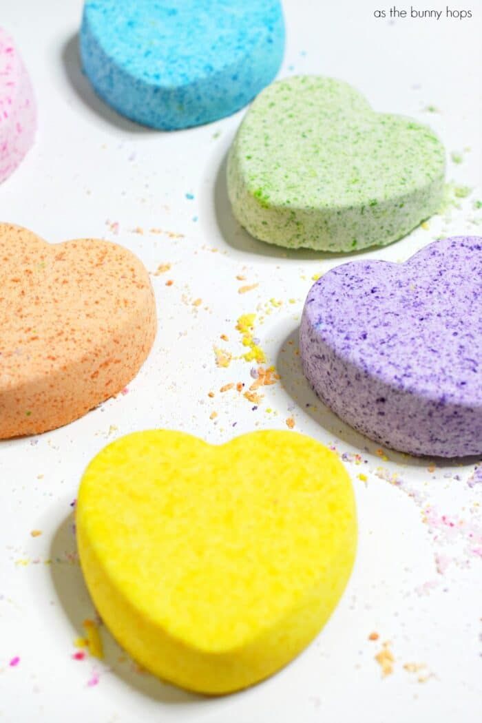 Conversation Heart Bath Bombs make a great DIY gift for Valentine's Day or Galentine's Day! Add personalized messages to create a custom gift. Get the full ingredient list and instructions at As The Bunny Hops.