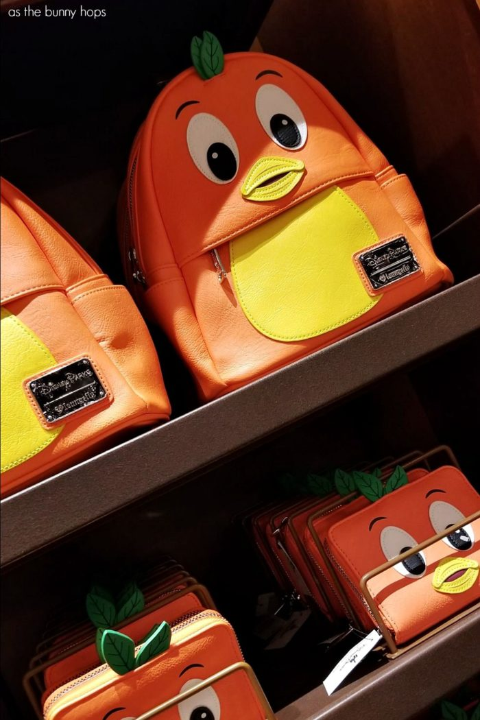 2909d36f923 Disney Parks Exclusive Orange Bird Backpack and Orange BIrd Wallet by  Loungefly on display in Uptown